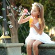 Caucasian lovely smiling child girl near fountain in sammer — Stock Photo