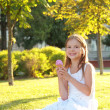 Smiling child eating ice-cream in summer park — Stock Photo #29245441