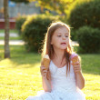 Contented smiling little girl is holding two ice creams — Stock Photo