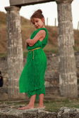 Adorable little girl in the emerald dress on a background of ancient sites of the ancient Greek city of Patikapey. — Stock Photo