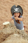 Girl pirate looking for treasure with a map of the sea. — Stock Photo
