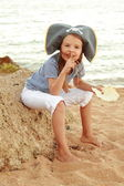 Caucasian emotional little girl in a hat with a symbol of maritime piracy — Stock Photo