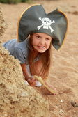 Emotional young girl in a pirate hat — Stock Photo