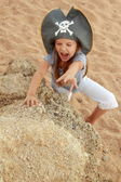 Adorable little girl in pirate hat — Stock Photo