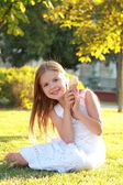 Smiling child eating ice-cream in summer park. — Stock Photo