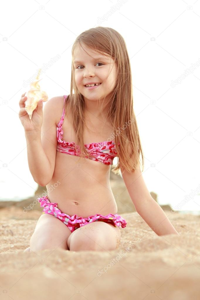 Portrait Of A Smiling Pretty Little Girl In A Swimsuit