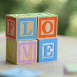 Word love from children's wooden blocks. Educational toys — Stock Photo #29418929