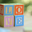 Word love from children's wooden blocks. Educational toys — Stock Photo #29418953