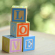 Word love from children's wooden blocks. Educational toys — Stock Photo #29418993