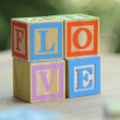 Alphabet for easy learning at a young age. Kids wooden blocks spelling — Stock Photo