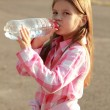 Cute little girl drinks water — Stock Photo #30063441
