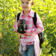 Little girl with a school bag — Stock Photo #30064597
