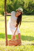 Smiling girl at a picnic — Stock Photo