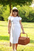 Young girl holding a basket — Стоковое фото