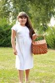 Girl in a picnic in summer park — Foto de Stock