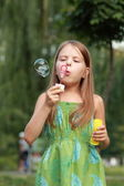 Beautiful girl played with soap bubbles — Photo