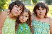 Three charming young girls — Stock Photo