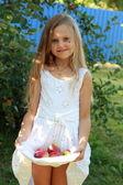 Little girl sitting on grass — Stock Photo