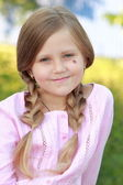 Girl with two plaits of hair — Stock Photo