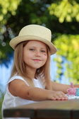 Cute little girl in a hat — Stock Photo
