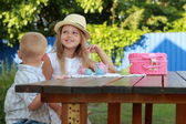 Little brother and sister playing with toys — Stock Photo