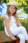 Girl in the yard on a summer day — Stock Photo