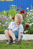 Little boy sitting on the track — Stock Photo