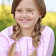 Cute girl with two plaits of hair — Stock Photo