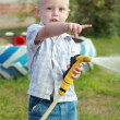 Happy little boy pours water from hose — Stockfoto #30070997