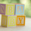 Word baby lined with children's wooden blocks for elementary education alphabet — Stock Photo