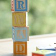Word read from the children's alphabet blocks for learning the alphabet — Stock Photo