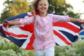 Young girl with the flag of the UK — Stock Photo