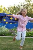 Girl holding a big flag of the European Union — Stock Photo