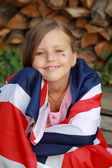 Adorable little girl with United Kingdom flag outdoors — Stock Photo
