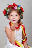 Beautiful little girl with traditional costume of Ukraine — Stock Photo