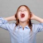 Angry little girl growls — Stock Photo