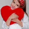 Little girl holds a big red heart — Foto de Stock