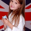Girl on the background of the flag of Great Britain — Stock Photo #31169917
