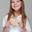 Girl holding a small paper heart — Stock Photo #31169955