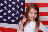 Girl on the background of the flag of the United States — Stock Photo