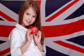 Girl on the background of the flag UK — Stock Photo