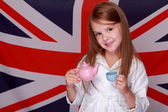 Girl on the background of the flag of Great Britain — Stock Photo