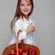 Stock Photo: Girl holding basket of apples