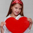 Girl with holds a big red heart — Foto de Stock
