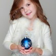 Girl holding a Christmas decoration — Stock Photo #31882233