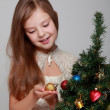 Child near Christmas tree — Stock Photo