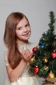 Girl near a Christmas tree — Stock Photo
