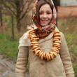 Girl in russivillage traditional kerchief — Stock Photo #34627765
