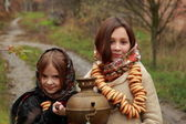 Young girls at autumn lanscape — Photo