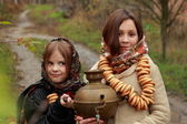 Young girls at autumn lanscape — Foto Stock